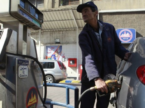 Worker in petrol station, Egypt. Credit: ANND