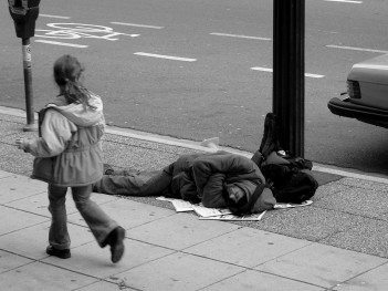 Homeless man sleeping in the streets of Vancouver, Canada. Photo: Jay Black