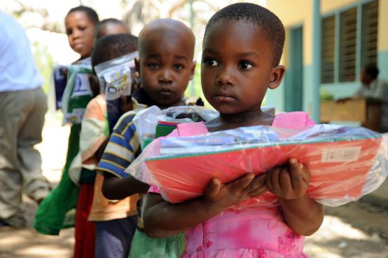 tanzanian-children-with-school-packs