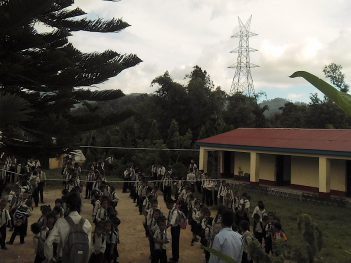 School children in Sindhuli, Nepal assembling near transmission tower Credit: LAHURNIP