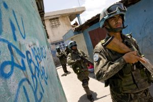 Peacekeepers patrol Haiti during elections.