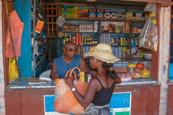 An unidentified woman buying in a typical grocery shop on Jan 27, 2004 in Ilakaka, Madagascar.
